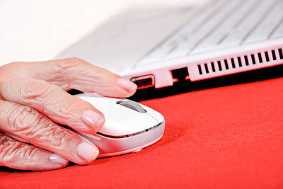 Elderly Woman Using A Computer Mouse Art Print