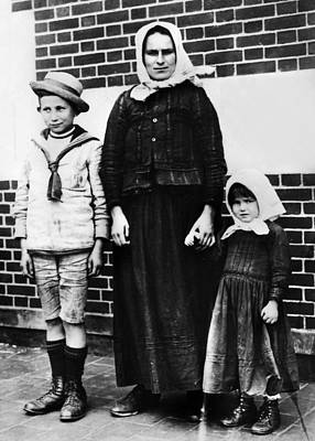 Photograph - Ellis Island Immigrants by Granger