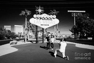Elvis Impersonators Photograph - elvis impersonator taking photos of tourists at the welcome to fabulous Las Vegas sign Nevada USA by Joe Fox