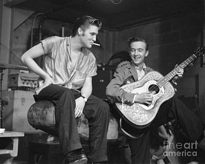Musicians Photo Rights Managed Images - Elvis Presley and his cousin Gene Smith 1956 Royalty-Free Image by The Harrington Collection