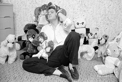 Musicians Photo Rights Managed Images - Elvis Presley at home with teddy bears 1956 Royalty-Free Image by The Harrington Collection