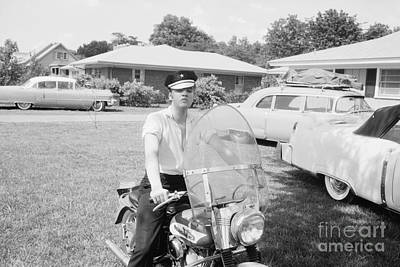 Musicians Photo Rights Managed Images - Elvis Presley sitting on his 1956 Harley KH Royalty-Free Image by The Harrington Collection