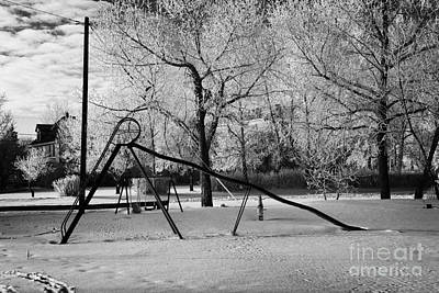 empty childrens playground with hoar frost covered trees on street in small rural village of Forget  Art Print