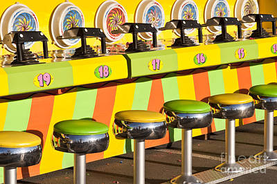 Little Mosters - Evergreen State Fair midway game with coloful stools and squirt  by Jim Corwin