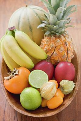 Exotic Fruit And Citrus Fruit In Wooden Bowl Art Print