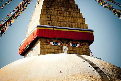 Eye Of Tibetan Stupa Boudnath And Buddhist Prayer Flags  Print by Raimond Klavins