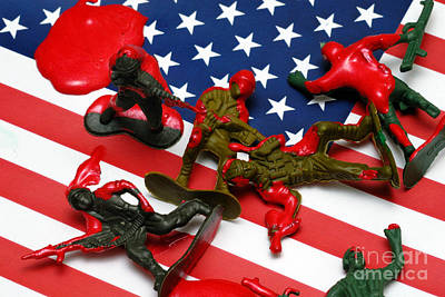Concept Photograph - Fallen Toy Soliders On American Flag by Amy Cicconi