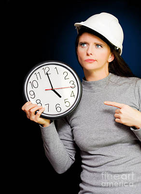 Female Construction Builder Pointing At Clock Print by Jorgo Photography - Wall Art Gallery