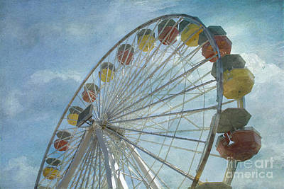 Photograph - Ferris Wheel Rotating Upright Wheel With Passenger Cars  by David Zanzinger