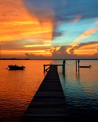 Photograph - Fire And Ice Is A Sunset Where The Sky, Clouds And Bay Are Split Into Red And Blue. by William Bartholomew