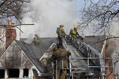 Fire Fighter Photograph - Firefighters Attending A House Fire by Jim West