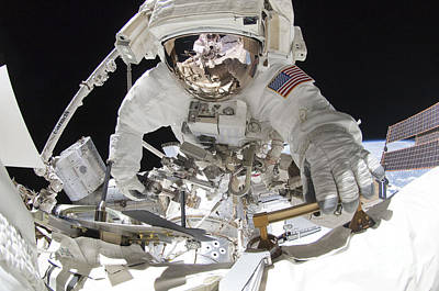 Fish-eye Look Photograph - Fish-eye Lens View Of An Astronaut by Stocktrek Images