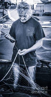 fisherman mending nets on Anzio harbour Art Print