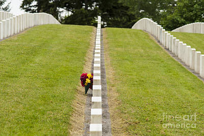 Photograph - Flowers Placed At Soldiers Gravesite by Jim Corwin