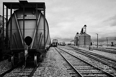 freight grain trucks on canadian pacific railway at assiniboia depot Saskatchewan Canada Art Print by Joe Fox