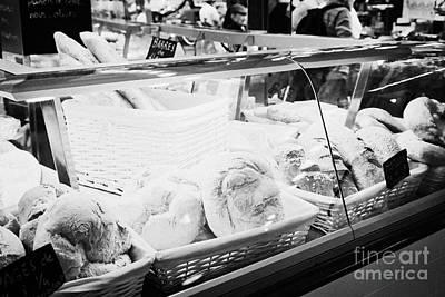 fresh artisan bread for sale inside the la boqueria market in Barcelona Catalonia Spain Art Print by Joe Fox