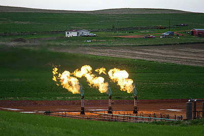 Gas Flares At An Oil Field Art Print by Jim West