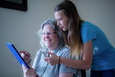 Grandma Photograph - Girl And Grandmother Using Tablet by Samuel Ashfield