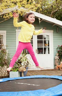 Girl Bouncing On A Trampoline Art Print by Ian Hooton