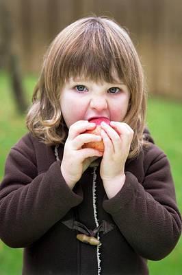 Bite Photograph - Girl Eating An Apple by Aberration Films Ltd