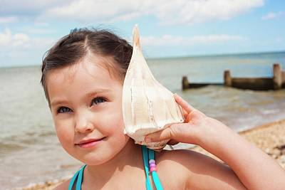 Sensory Perception Photograph - Girl With Seashell by Ian Hooton