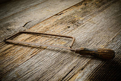 Handsaw Photograph - Hand Saw On Rustic Wood Background by Brandon Bourdages