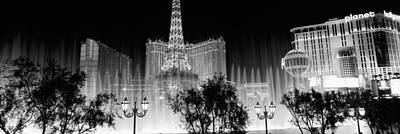 The Eiffel Tower Photograph - Hotels In A City Lit Up At Night, The by Panoramic Images