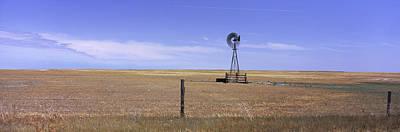 Industrial Windmill On A Landscape Art Print