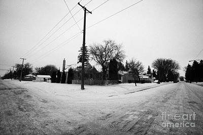 intersection of snow covered residential streets Saskatoon pleasant hill Saskatchewan Canada Print by Joe Fox