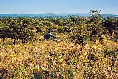 Watch Photograph - Jeep With Tourists On Safari In Serengeti. Tanzania. Africa. by Michal Bednarek