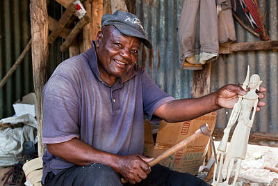 Wooden Photograph - Kenya. December 10th. A Man Carving Figures In Wood. by Michal Bednarek