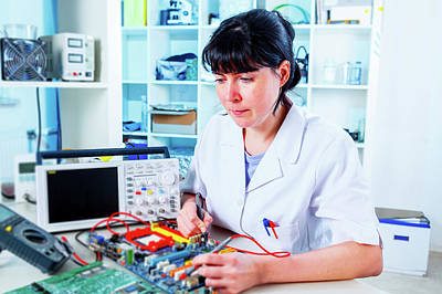 Circuit Photograph - Lab Assistant Working On Circuit Board by Wladimir Bulgar