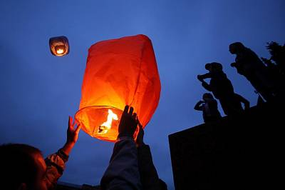 Launching Wish Lanterns Art Print by Science Photo Library
