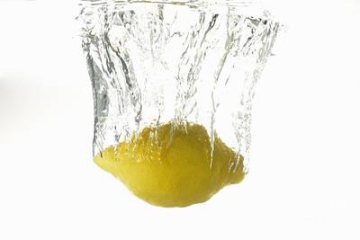 Lemon Splashing Underwater Art Print by Sami Sarkis