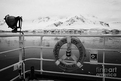 Fournier Photograph - lifebelt on expedition ship covered in snow moored in Fournier Bay on Anvers Island Antarctica by Joe Fox