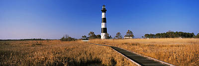 Lighthouse In A Field, Bodie Island Art Print by Panoramic Images