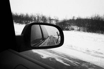 looking at side view mirror winter driving along Saskatchewan highway 11 from Saskatoon to Regina Ca Art Print
