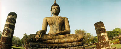 Sukhothai Photograph - Low Angle View Of A Statue Of Buddha by Panoramic Images