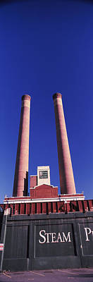 Low Angle View Of Two Smoke Stacks Art Print by Panoramic Images