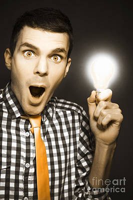Male Business Person With Light Bulb In Hand Art Print by Jorgo Photography - Wall Art Gallery