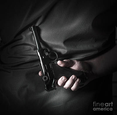 Male Hand Hiding Vintage Luger Pistol Behind Back Art Print by Jorgo Photography - Wall Art Gallery