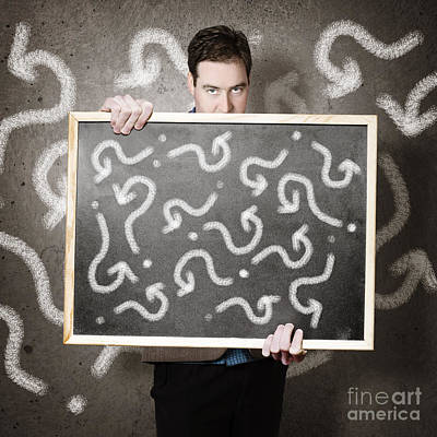 Photograph - Man Holding Direction Sign With Arrow Questions by Jorgo Photography - Wall Art Gallery