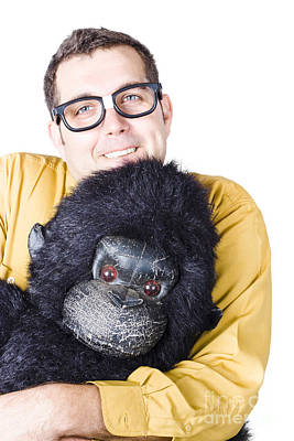 Comics Royalty-Free and Rights-Managed Images - Man holding gorilla costume by Jorgo Photography - Wall Art Gallery