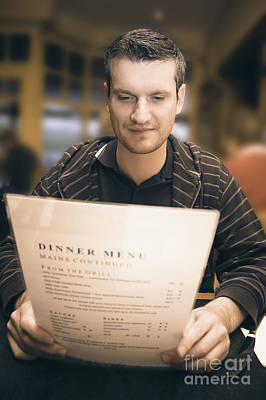 Man In Mid 20s Reading Restaurant Dinner Menu Art Print