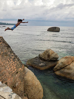 Southern Province Photograph - Man Jumping Off Flag Rock Bastion by Panoramic Images