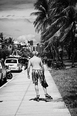 Man Rollerblading Along Ocean Drive Early Morning Art Deco District Miami South Beach Florida Usa Art Print by Joe Fox