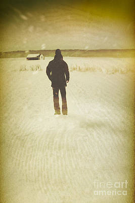 Photograph - Man Walking In Snow Storm Towards A Barn by Sandra Cunningham