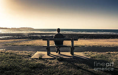 Man Watching Australian Sunset On Park Bench Art Print by Jorgo Photography - Wall Art Gallery