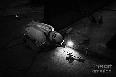 Arc Welder Photograph - man welding metal plates together on the street Las Vegas Nevada USA by Joe Fox
