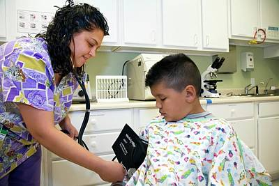 Mexican American Photograph - Measuring A Child's Blood Pressure by Jim West